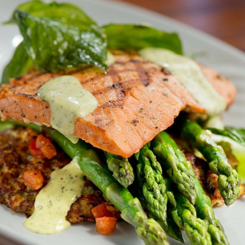 Fresh salmon over asparagus