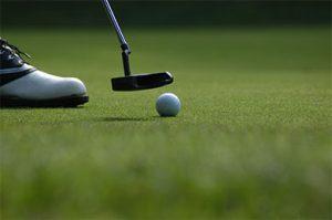 Putting On Golf Green