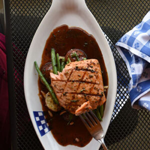 Grilled salmon on Duke's Seafood plate with green beans and potatos