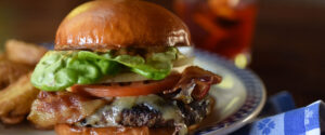Dukes Seafood Cheeseburger with bacon, lettuce, tomato, and onion