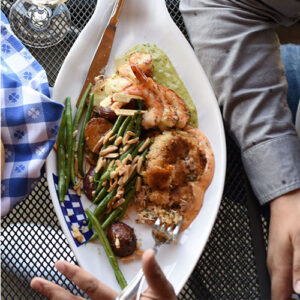 Plate of prawns, green beans, and potatoes
