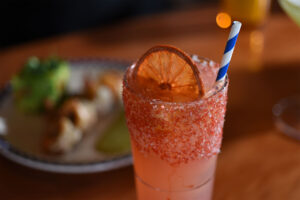 Duke's cocktail with orange citrus wedge
